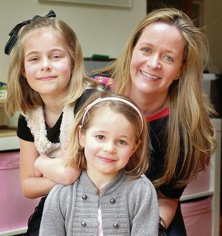 Gillian De Marco with daughters Katie (7) and Emily (5). Photo by Ronan Lang