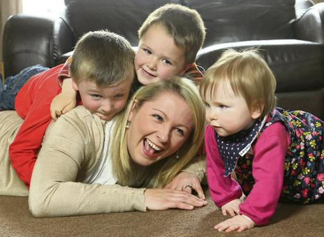 Sinead Fox with sons Ciaran, Cathal and daughter Laoise.