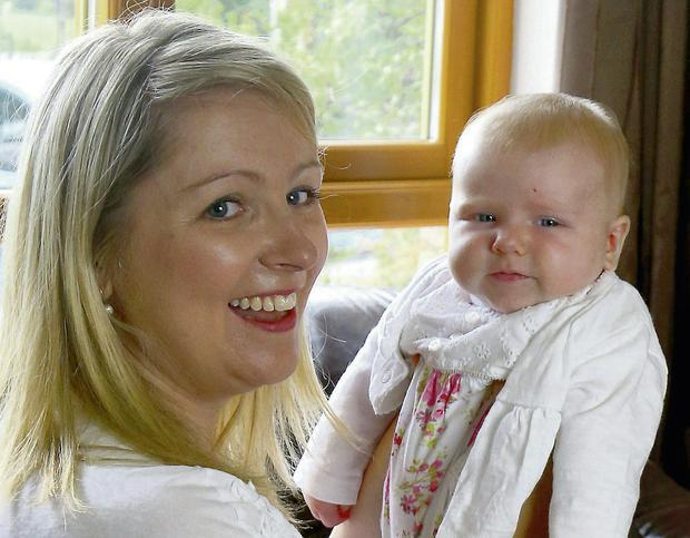 Sinead with Laoise when she was three-months-old