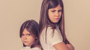 It is often our children's perception of an inequality in the allocation of time or attention that leads to frustration or enmity towards siblings. Picture posed