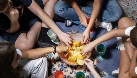 Having friends over for sleepovers, complete with treats and fizzy drinks, is a way to keep the gang together. Picture posed