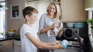 Doing the chores together makes them relationship-building activities. Photo: Stock