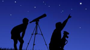 Star gazing with the family. Stock photo