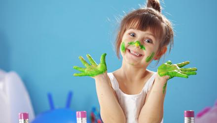 Children love to get creative - and messy! - with art. Picture posed