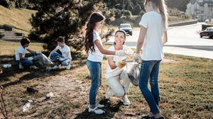 Doing small things such as picking up rubbish helps children deal with eco-anxiety. Photo: Stock image