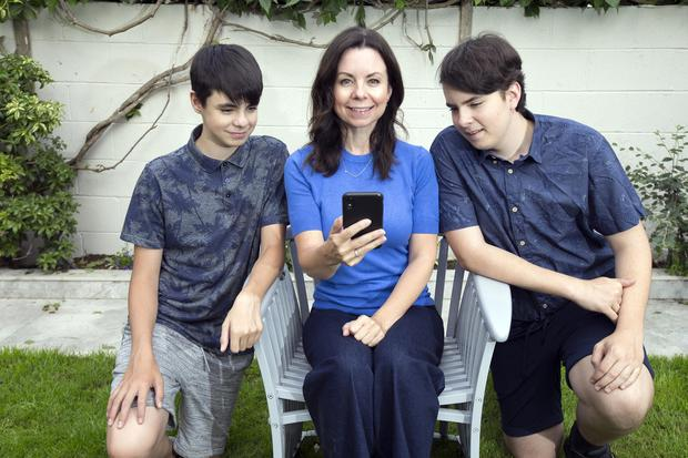 Ollwyn Moran with her sons Alex (14) and Matthew (16), who were not allowed their first mobile phones until after their Junior Cert. Photo: Tony Gavin