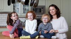 Andrea Mara at home with her children Elissa, Nia and Matthew in Dun Laoghaire. 'I've come to realise that you don't have to do elaborate things with your children,' says Andrea. 'It's the simple stuff that they love best.' Photo: Peter Houlihan