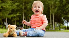 Apart from being tired or hungry, toddlers may just be frustrated that their movements are being restricted by us. Stock image