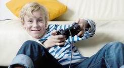 I'm looking forward to the summer holidays playing my Xbox, but my Mum has different ideas. Stock image