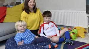 Little ears: Chrissie Russell is careful when talking about her own dieting in front of her sons Finn and Tom