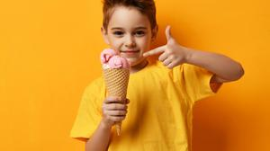 A good way to reward your child is to say they can have an ice-cream after dinner if they hold off on eating a biscuit beforehand. Photo: Deposit