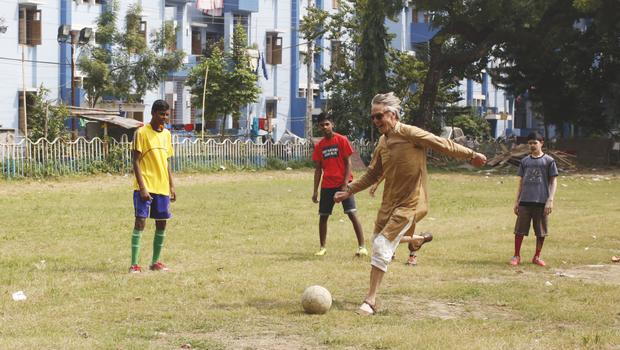 Irons enjoying a game of football with the boys from a boys' Protection Home, which is funded and operated by the Hope Foundation