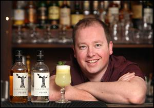 Barman Tom O'Brien with one of hius 'Poitin Sours' cocktails at the Exchequer Bar.