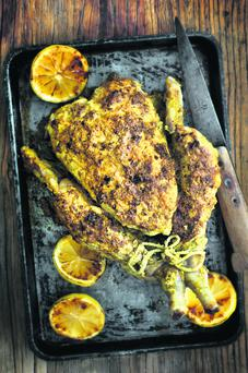 Pan-roasted whole chicken with carom seeds.