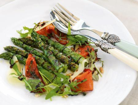 Grilled asparagus with red peppers, parmesan and balsamic reduction