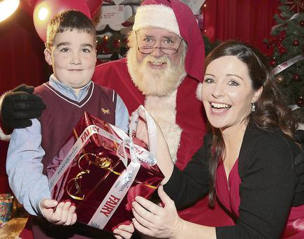 Santa and celebrity chef Catherine Fulvio with Make A Wish boy Andrew Burke