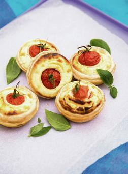 Goats cheese and tomato tartlets.