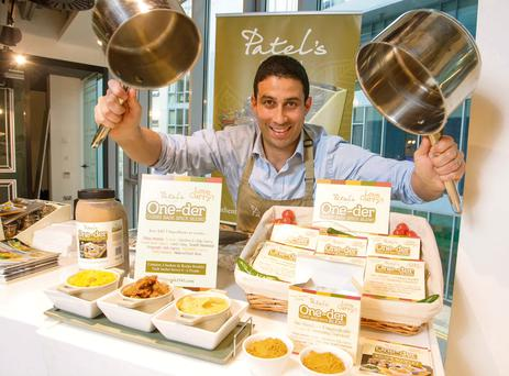 EIGHT DIFFERENT CURRIES — ONE LITTLE PACKET: Raman Patel, of Patel's Food Co, demonstrates how easy it is to make one of eight perfect curries with his new One-der Curry Base Spice Blend range. Photo: Joe Keogh