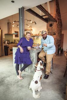 Jane and Myles in their new home with their dog