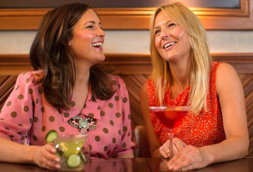 HAIR, HAIR: Restaurateur Laura Peat (right) thinks it's most unfair that her little sister Joanne (left) got such effortlessly good tresses. Photo: Fergal Phillips
