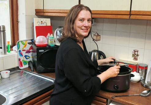 Alison Kelly preparing a meal in her slow cooker at her home in Galway. Photograph: Andrew Downes