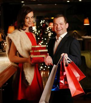 Karen Fitzpatrick is pictured launching the shop, drop and flop initiative with Suesey Street's general manager John Healy