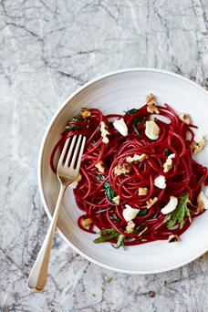 Beetroot noodles with goat's cheese, toasted walnuts and baby kale
