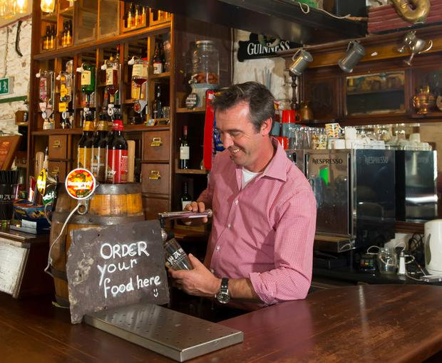 The chef pulls a pint in 'The Local'. Photo: Patrick Browne.