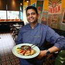 Currying favour: Chef Sunil Ghai pictured with his goat curry in Pickle on Camden Street. Photo: Frank Mc Grath