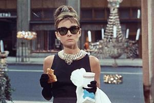 Holly Golightly with a pastry in Breakfast at Tiffany's