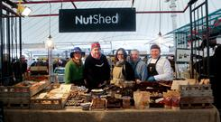 MARKET FORCES: Kirsti O'Kelly, Silver Darlings fish; Declan Gaffney, who has a bread/eggs stall; Evie Ward, NutShed; Chris Young, The Irish Chilli Farm; Sefik Dikyar, who has a baklava stall, in the Milk Market in Limerick. Photo: Brian Arthur