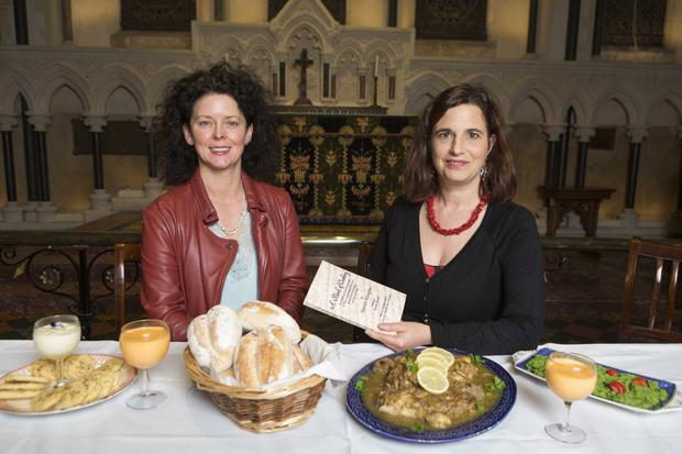 Repast from the past: Mary Farrell (left), chef at Morton's, and historian Dr Deirdre Nuttall at St Patrick's Cathedral with meal they've created based on original recipes from Nuttall's ancestor Hannah Alexander. Photo: Kip Carroll