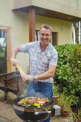Grill king: Kevin Dundon on BBQ duty at Dunbrody House. Photo by Kyle Tunney