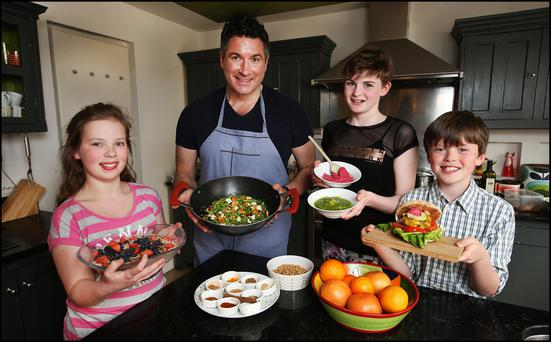 Oliver Mc Cabe with Amber O'Dwyer (12), Maia Murphy (12) and James O'Dwyer (10) in the O'Dwyer family kitchen in Dalkey.