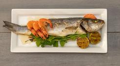 Steam Roasted Fragrant Sea Bass with Chargrilled prawns & Roasted Lime