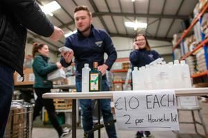 Members of the public queue to buy bottles of hand sanitiser made and sold at Listoke Distillery and Gin School in Tenure, north Dublin
