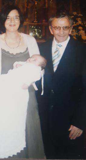 Jackie with her dad at her daughter Aoife's christening in 2006