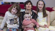 Louise Milicevic, who has cerebral palsy, with her children Afric, age 11, Amelie, 9 and Sadhbh, 10 months at their home in Kildare. Photo: Arthur Carron