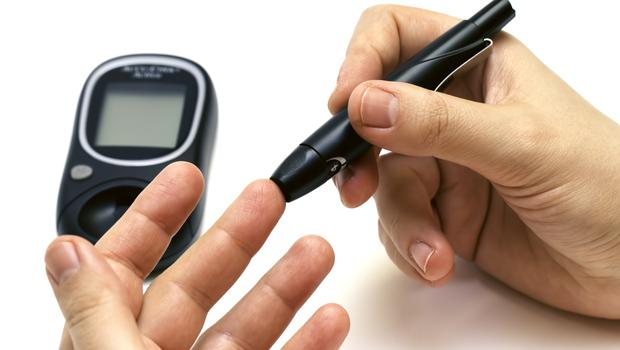 A blood glucose monitor as used by diabetics