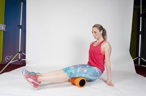 HAMSTRING 1/ Start by sitting on the foam roller on your hamstrings, leaning back and supporting yourself with your two hands while your hamstrings are resting on the roller. Gently allow the roller to work its way down the hamstring by pushing the glutes out. Repeat numerous times.
