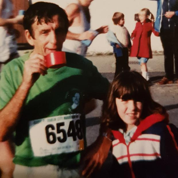 A young Jackie with her dad when he completed the Dublin Marathon