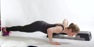 Uni box push up 1. Start by supporting your body on your toes with one hand on a low step, box or step is ideal if you are at home, and the other on the floor, elbows bent and your chest nearly touching the floor.