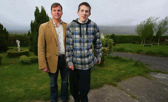 Fears: Neil van Dokkum and his son Ian moved to Kilmacthomas, Co Waterford, in search of a peaceful environment Photo: Patrick Browne