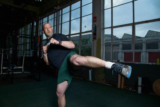 Doing it for kicks: Irish kickboxing champion Colin O'Shaughnessy pictured at Cork City port last week. Photo: Clare Keogh