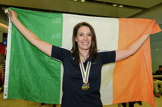 FLAG BEARER: Caroline returns home with her bronze medal.