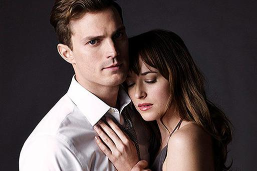 Jamie Dornan as Christian Grey with Dakota Johnson in 'Fifty Shades of Grey'