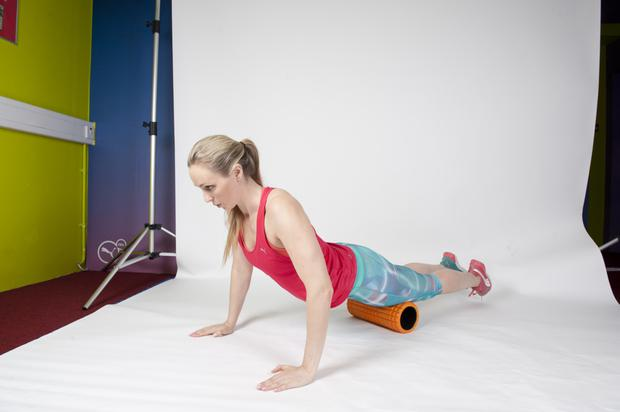 QUAD: 1/ Start in what will look like a push-up position, with your quads leaning on the foam roller.