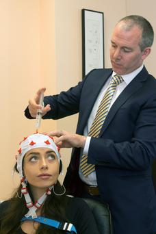 Katie Byrne road-testing neurofeedback with Dr Michael Keane at the Healthy Living Centre in DCU. Photo: Mark Condren