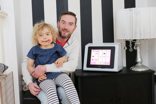Innovation: Rob and Sadie Laffan with the 'Tippy Talk' machine he developed for her. Photo: Press 22