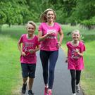 Vivienne Connolly, her son Ben (11), and daughter Katie (8) train for the Great Pink Run for Breast Cancer Ireland in the Phoenix Park. Photo: Arthur Carron